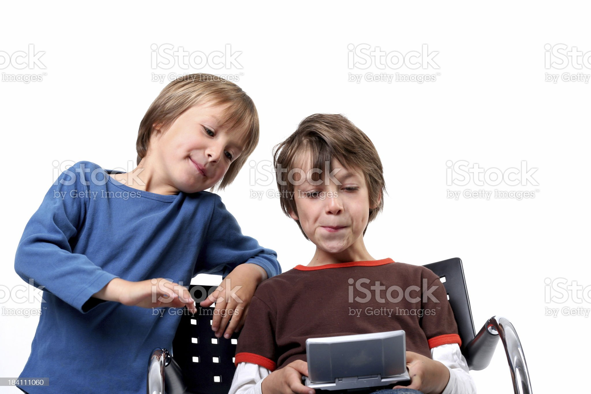 two boys playing a video game white background royalty-free stock photo