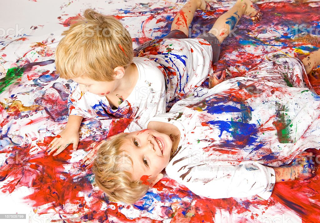 Two Boys Playing in Paint royalty-free stock photo