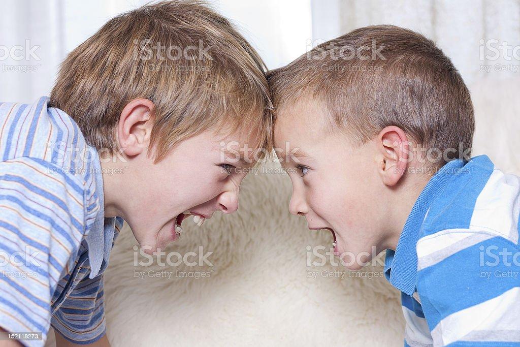 Two boys quarrels stock photo