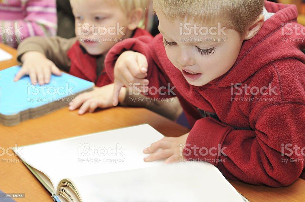 Two Boys Reading Books royalty-free stock photo