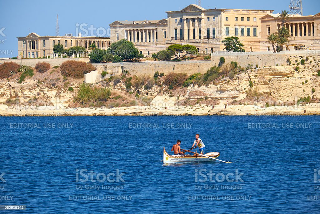 Two boys rowing in the boat on the water of Grand stock photo