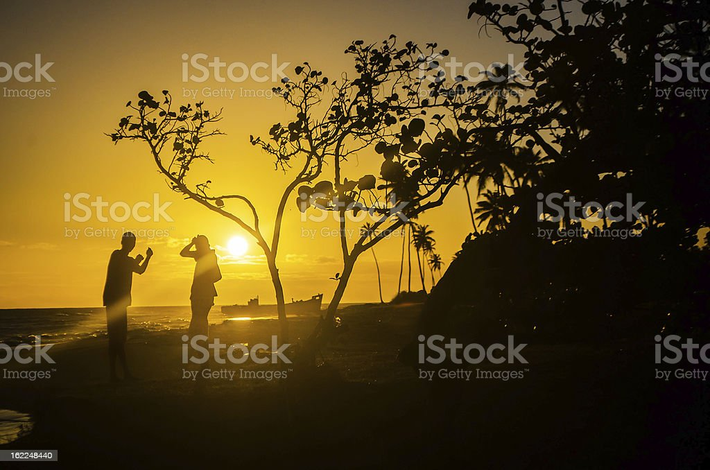 two boys silhouette in spectacular golden sunset royalty-free stock photo