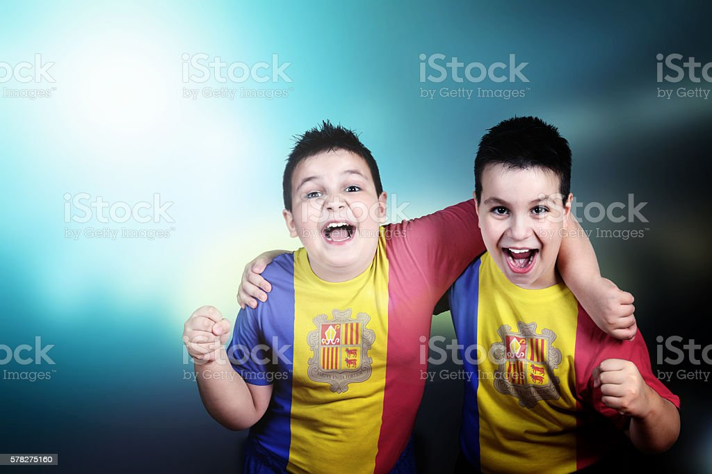 Two boys soccer fans with flag of Andorra on t-shirt stock photo