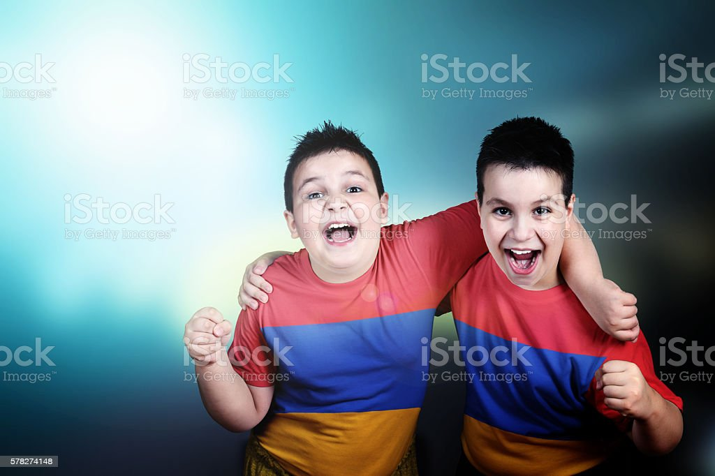 Two boys soccer  fans with flag of Armenia on t-shirt stock photo