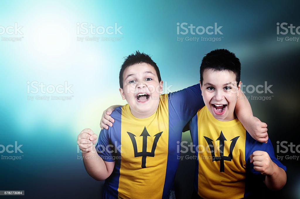 Two boys soccer  fans with flag of Barbados on t-shirt stock photo