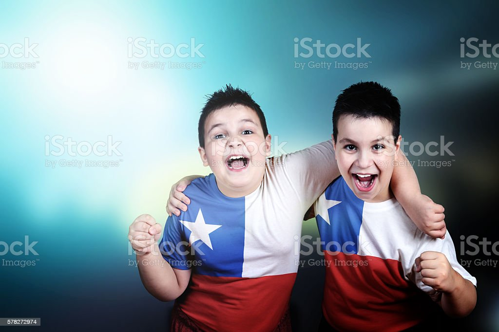 Two boys soccer fans with flag of Chile on t-shirt stock photo