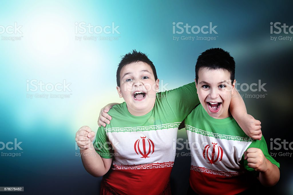 Two boys soccer fans with flag of Iran on t-shirt stock photo