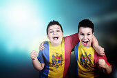 Two boys soccer fans with flag of Moldova on t-shirt