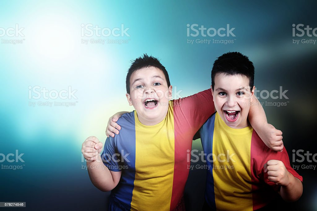 Two boys soccer fans with flag of Romania on t-shirt stock photo