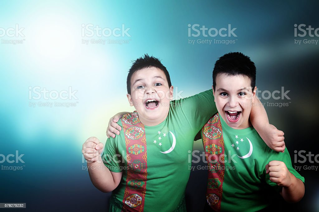 Two boys soccer fans with flag of Turkmenistan on t-shirt stock photo