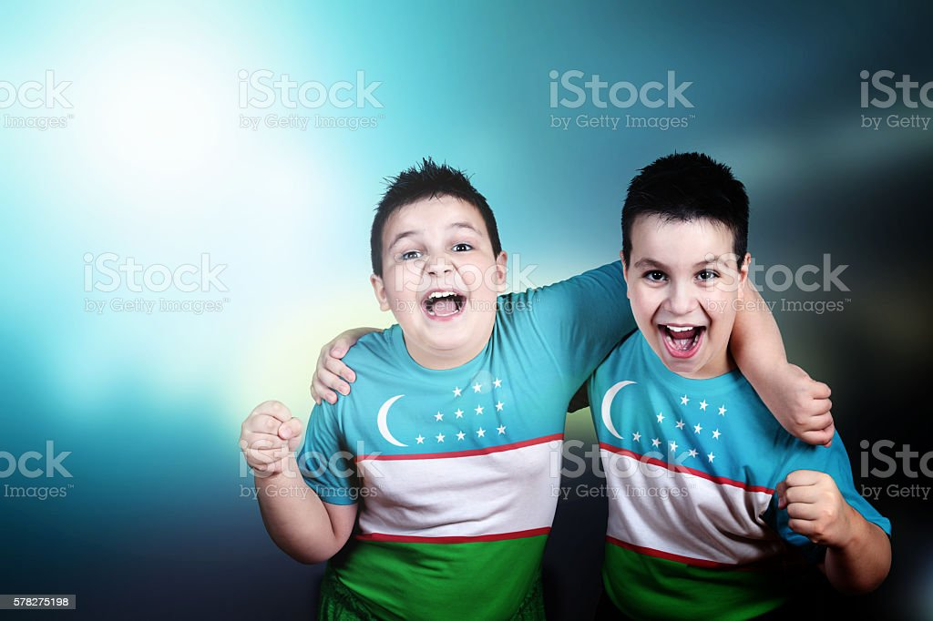 Two boys soccer fans with flag of Uzbekistan on t-shirt stock photo