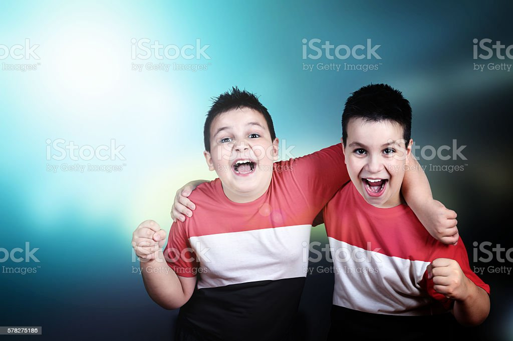 Two boys soccer fans with flag of Yemen on t-shirt stock photo
