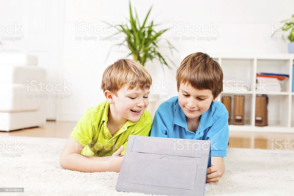 Two boys using a digital tablet royalty-free stock photo