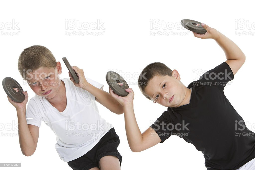 Two boys weightlifting stock photo