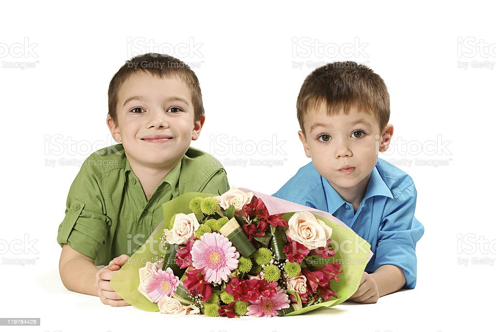 Two boys with bouquet of flower stock photo
