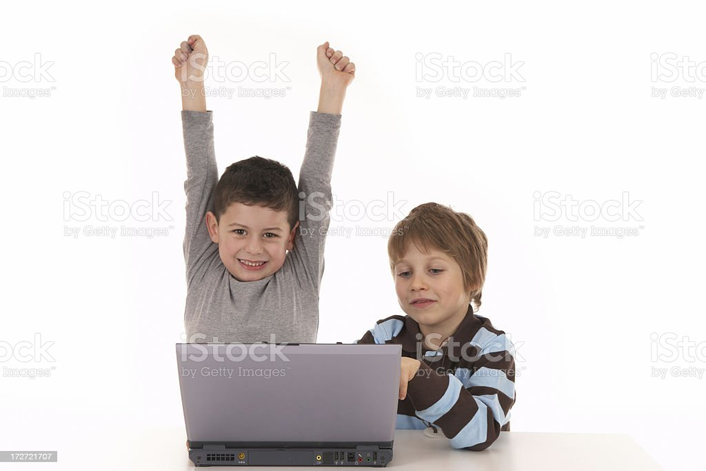 two boys with notebook series - winning royalty-free stock photo