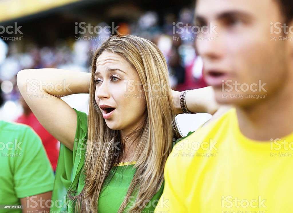 Two Brazilian soccer fans are worried about their team's performance royalty-free stock photo