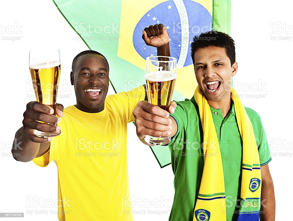 Two Brazilian soccer supporters toast their team excitedly royalty-free stock photo