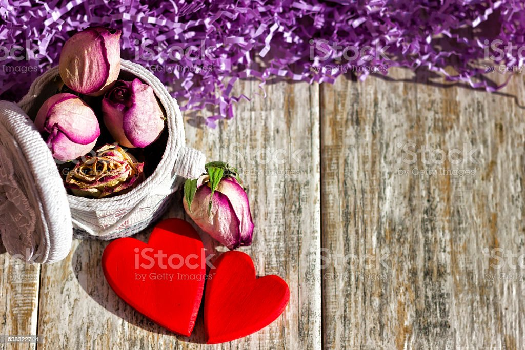 Two bright hearts on a wooden background stock photo