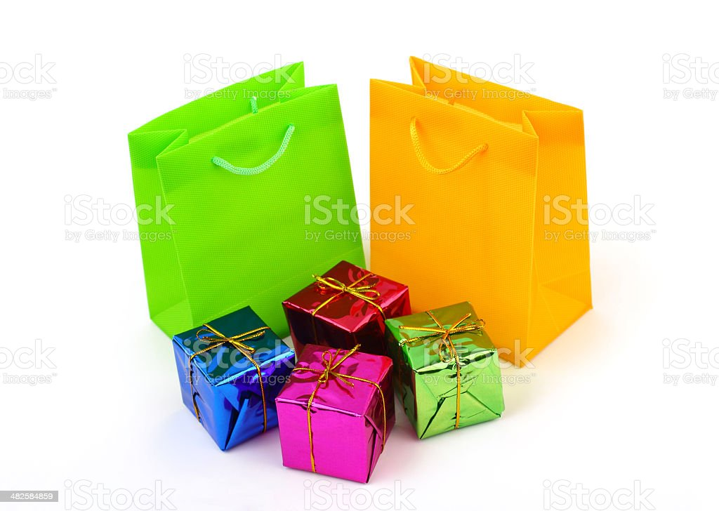 Two bright shopping bags with four small presents stock photo