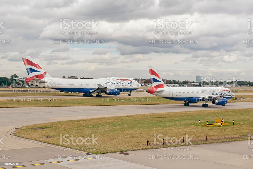 Two British Airways Aircraft at London Heathrow Airport stock photo