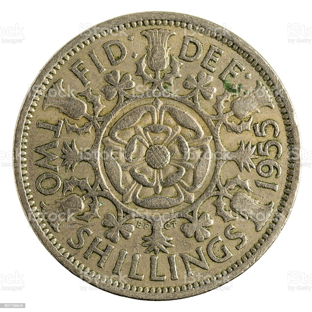 two british shillings coin (1955) isolated on white background stock photo