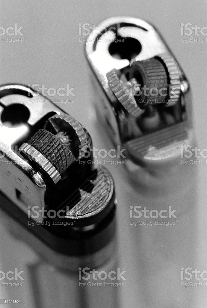 Two Broken Lighters stock photo