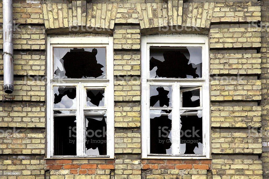 Two broken windows stock photo