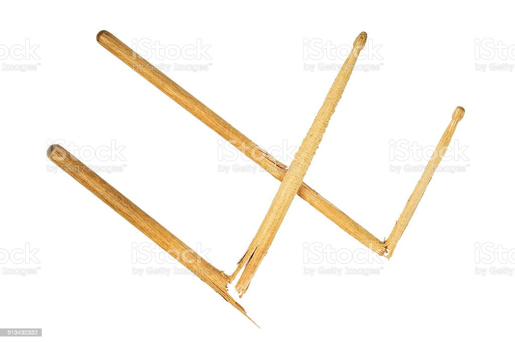 Two broken wooden drumsticks isolated on white royalty-free stock photo