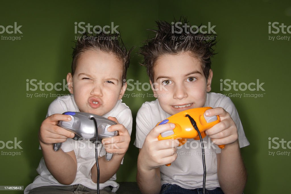 Two brother playing video games stock photo