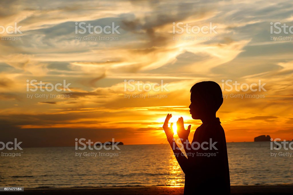 Two brother praying stock photo