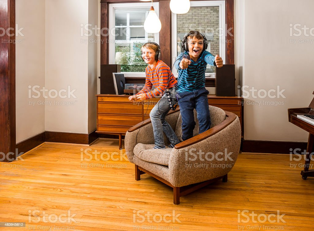 Two brother rocking out at home stock photo