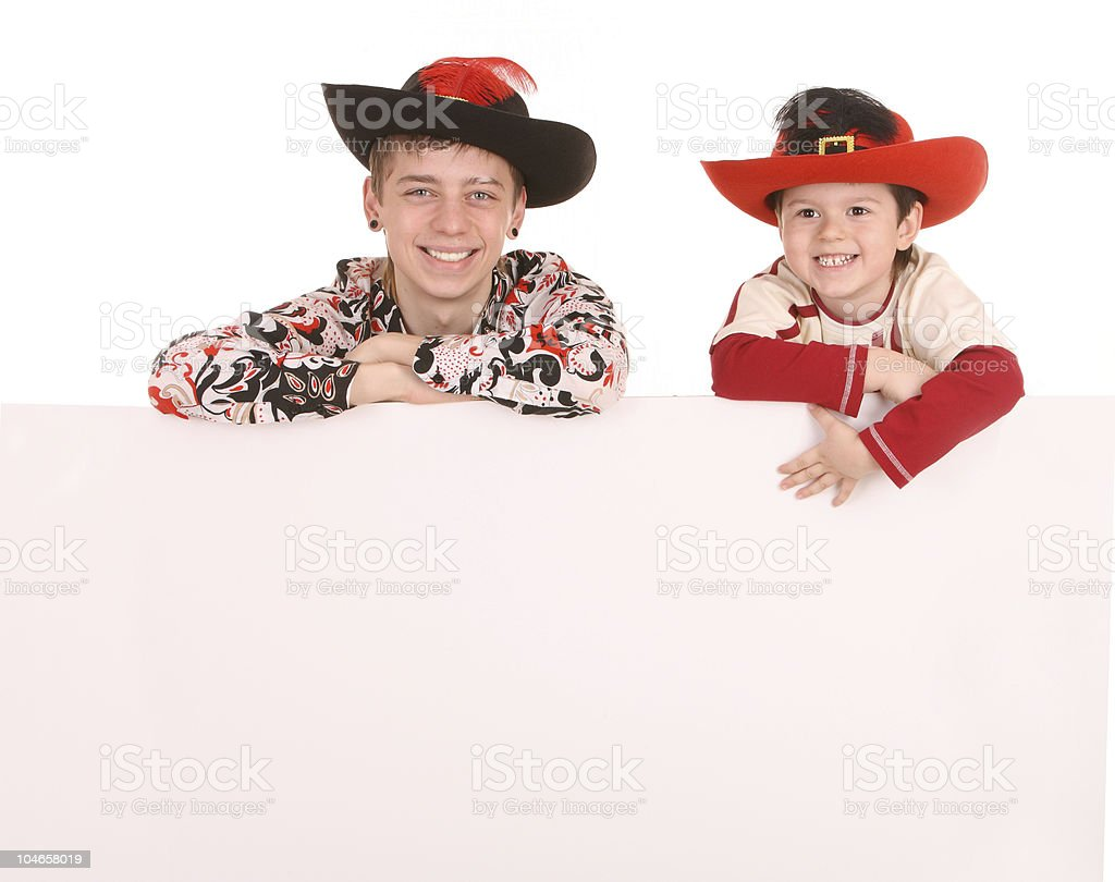 Two brother with white banner. royalty-free stock photo
