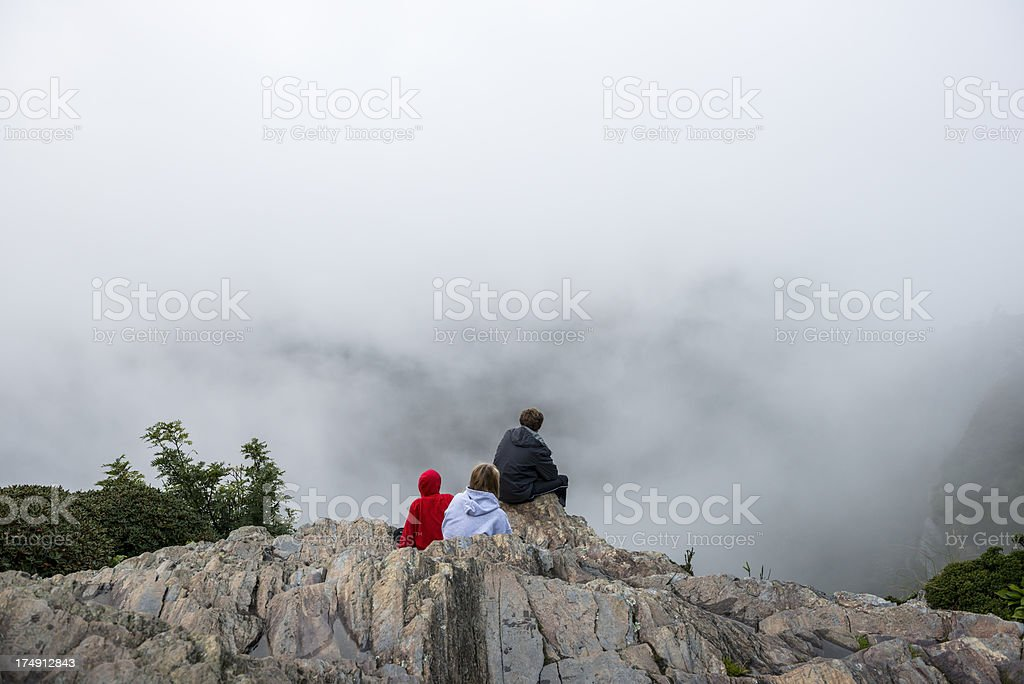 Siblings on foggy mountaintop in Great Smoky Mountains National Park stock photo