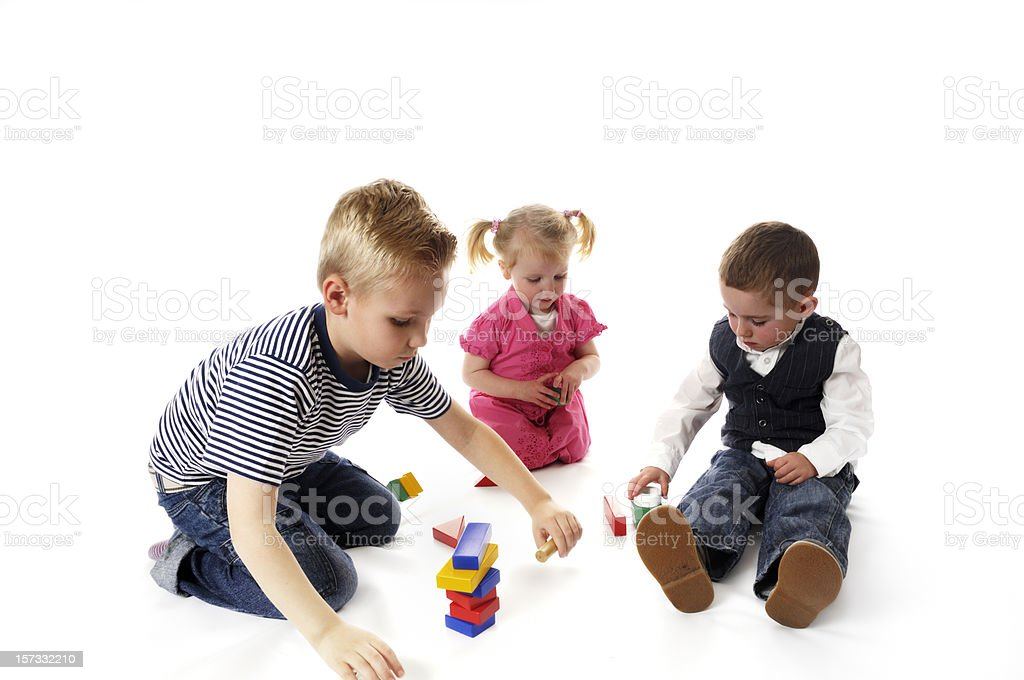 two brothers and sister playing royalty-free stock photo