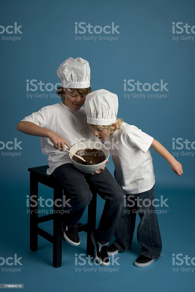 Two Brothers Bake Brownies stock photo