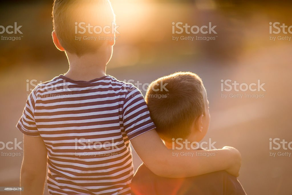 Two brothers hugging with brotherly love stock photo