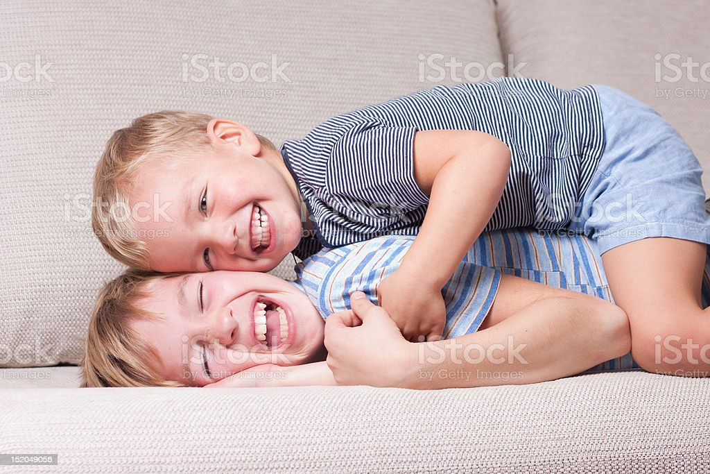 Two brothers laugh. royalty-free stock photo