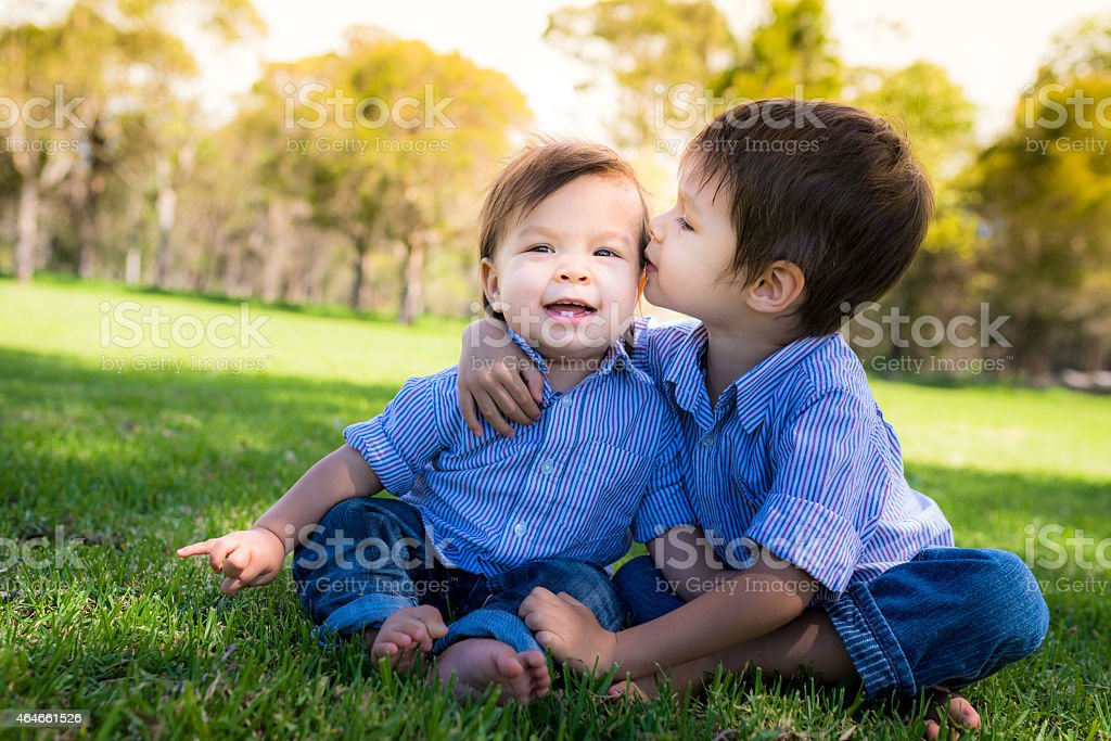 Two brothers playing in the park stock photo