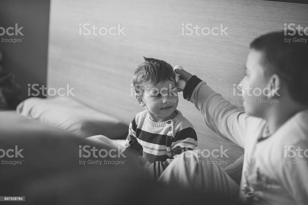 Two brothers playing stock photo