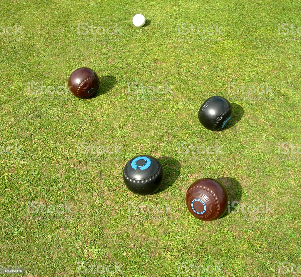 Two Brown  2 Black Lawn Bowls stock photo