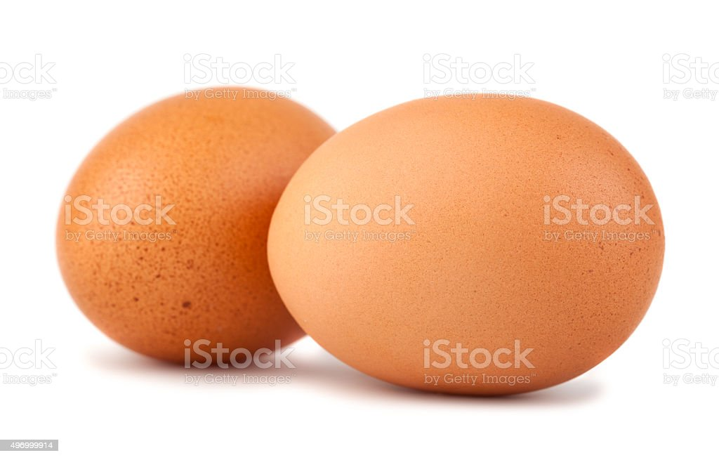 Two brown chicken eggs stock photo