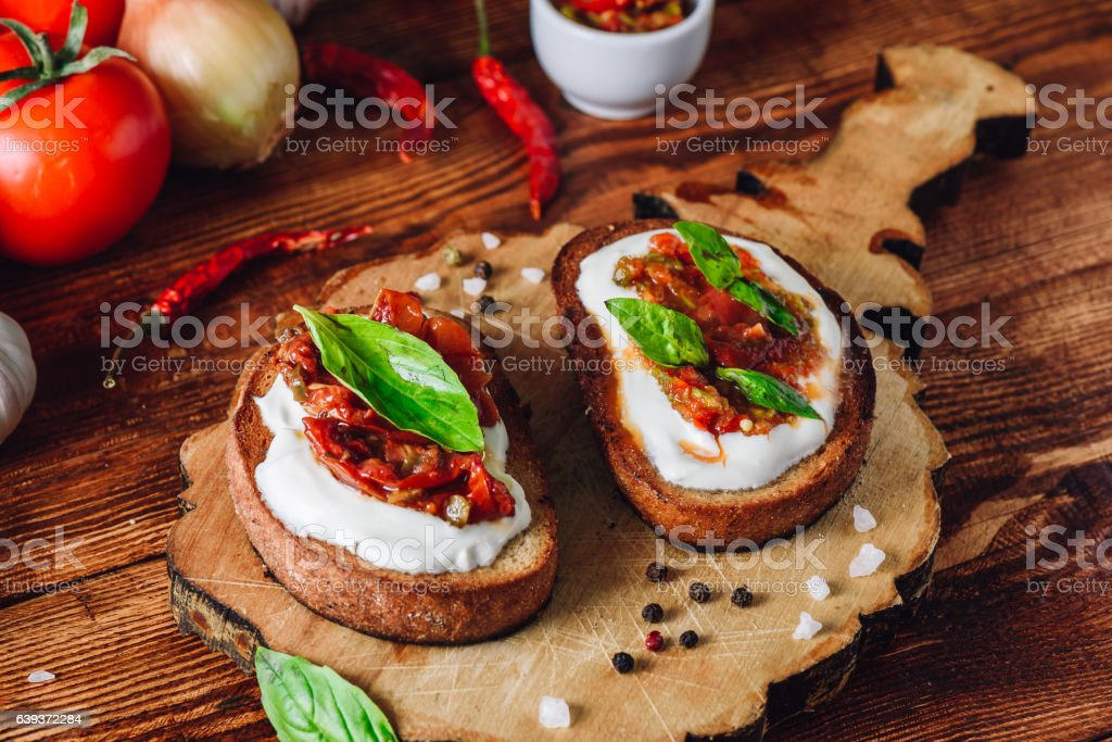 Two Bruschettas with Tomatoes and Spicy Sauce stock photo