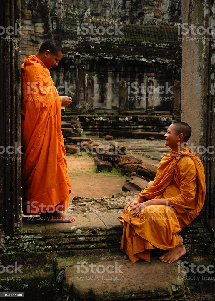 Two Buddhist Monks Talking royalty-free stock photo