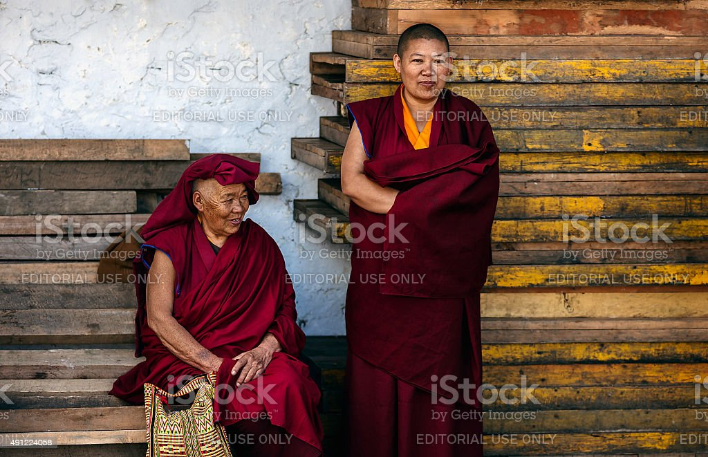 Two Buddhist nuns at Tawang monastery, Arunachal Pradesh, India. stock photo