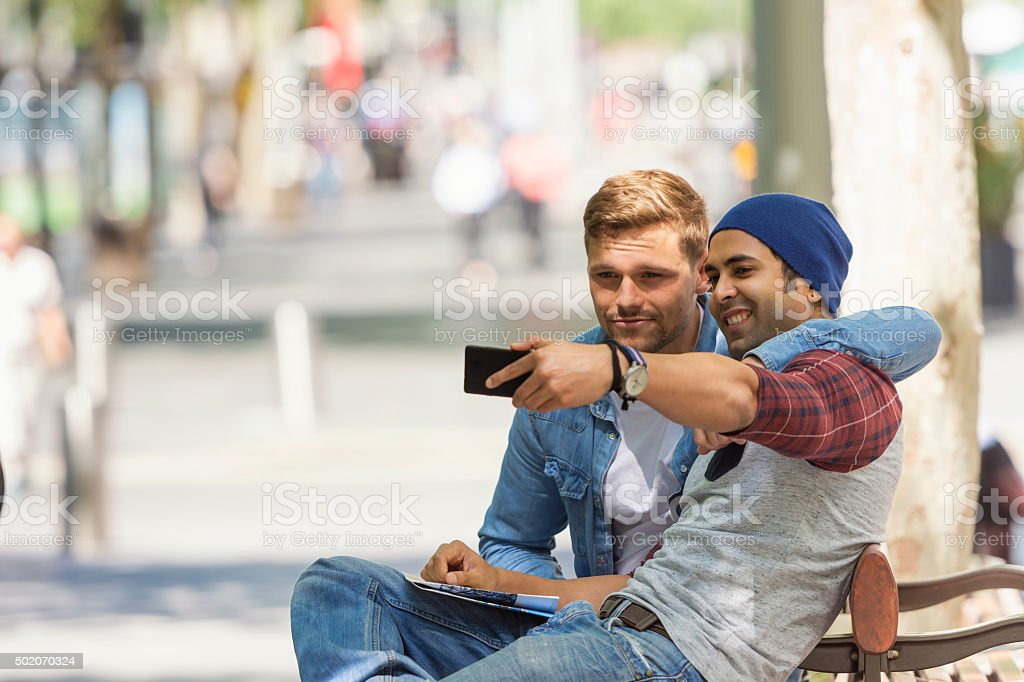 Two buddies taking a selfie stock photo