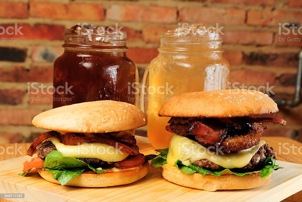 Two burgers with drinks vintage style stock photo