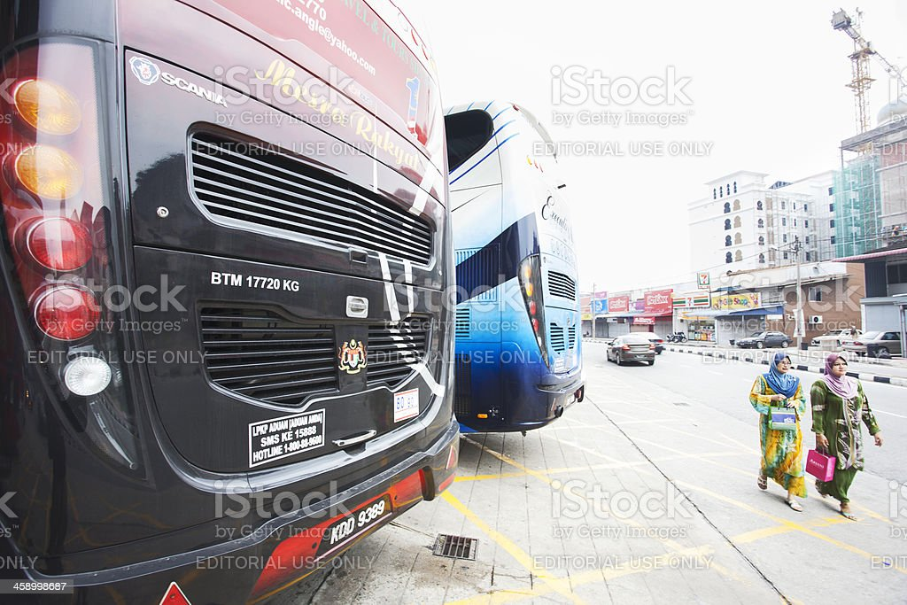 Two buses parked at bus station. stock photo