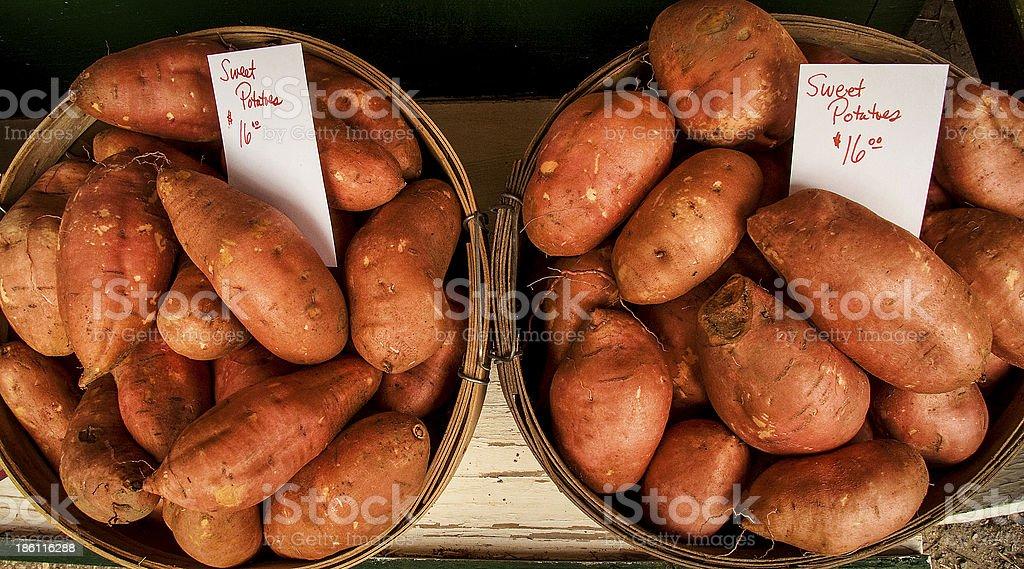 Two bushels of sweet potatoes for sale stock photo
