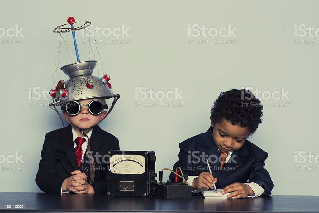 Two Business Boys Maximize Ideas with Mind Helmet stock photo